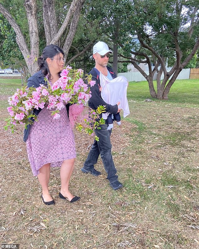 A couple who witnessed the magpie swoop on baby Mia and her mother Simone lay flowers at the scene in Holland Park West, Brisbane