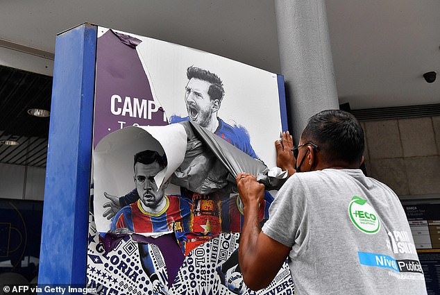 Lionel Messi posters are TORN DOWN from outside Barcelona's Camp Nou stadium as he nears PSG move | Daily Mail Online