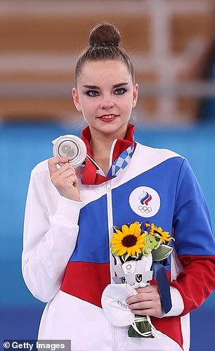 Russian rhythmic gymnastDina Averina poses with a silver at the Olympics in Tokyo