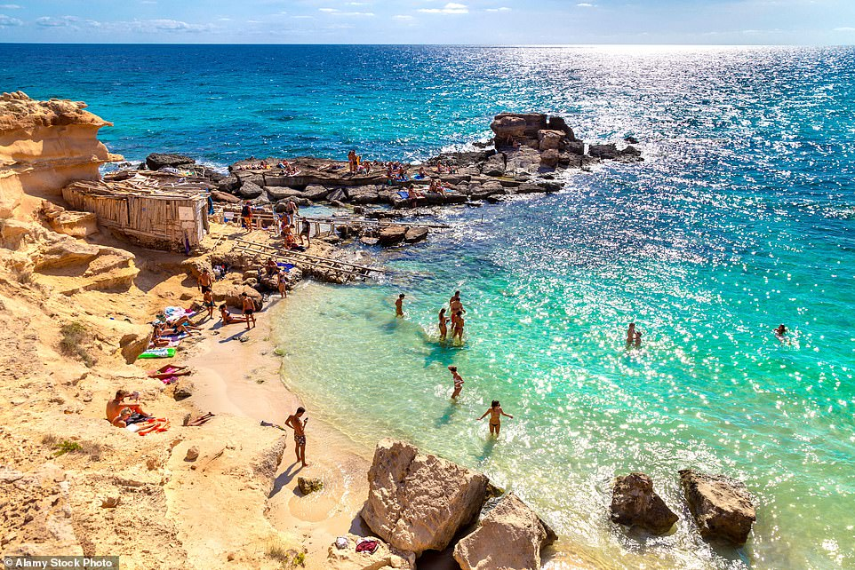 Calo des Mort beach (pictured) on Formentera is famed for its stretches of golden sand. Tourists in Ibiza can access Formentera, the smallest of the Balearic Islands, by ferry
