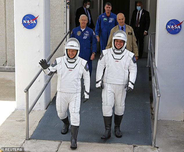 Although SpaceX's focus is developing rockets, Musk has dabbled in making suits: the CEO personally worked on the white suits used in the Dragon Crew missions (pictured)