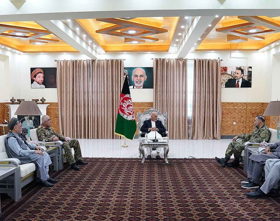 President Ghani (centre) is pictured meeting with Noor (right) and another feared anti-Taliban warlordAbdul Rashid Dostum (left) as they prepare to defend Maza-i-Sharif from the Taliban