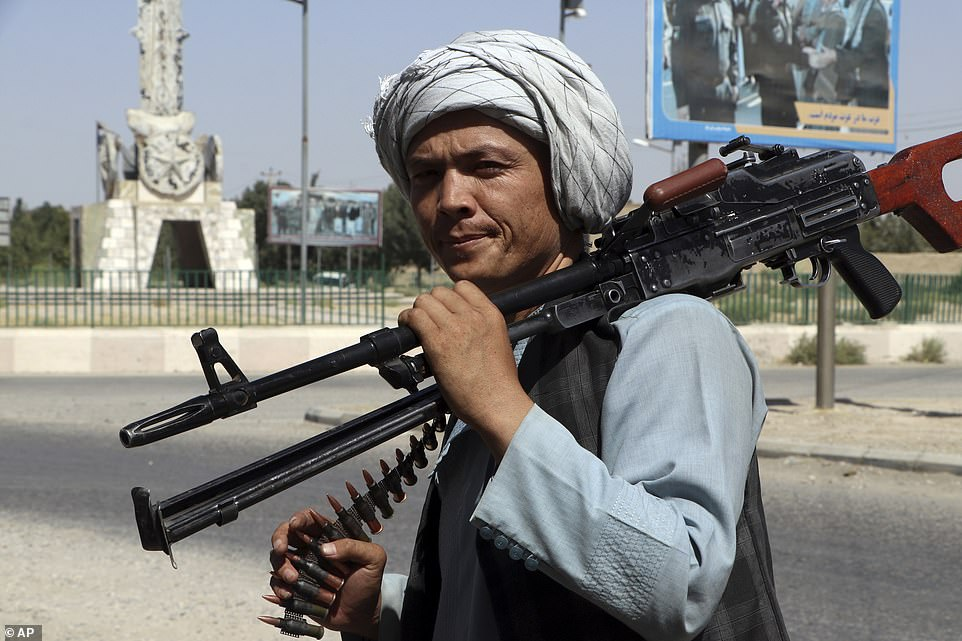 A fighter loyal to warlordAta Mohammad Noor, the strongman leader of Mazar, poses with a heavy machine gun ahead of an expected Taliban assault on the city