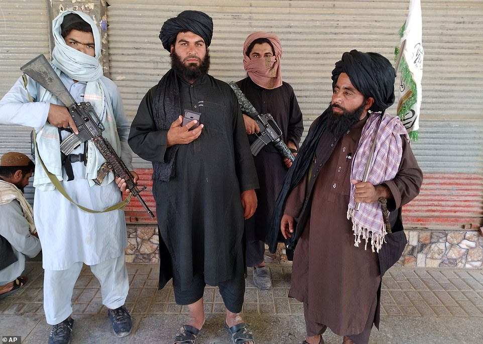 Taliban fighters are pictured in the city of Farah, one of nine they have seized in less than a week as they push to retake the country