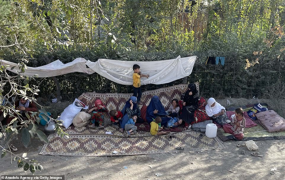 Families rest in a camp in Kabul after they fled their homes due to fear of the Taliban and sought shelter in government areas