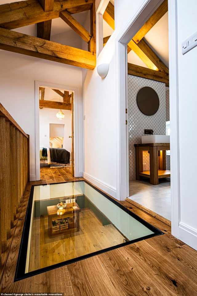 Upstairs, the couple built a glass panel into the corridor of their hallway and kept more of the building's original character with wooden beams (pictured)