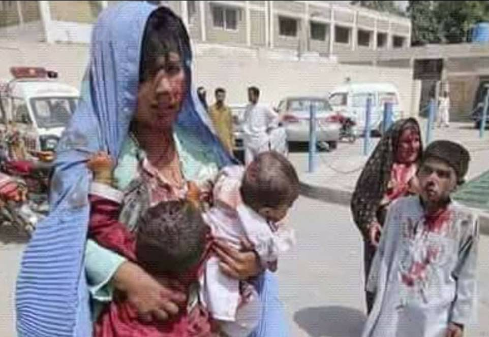 A blood-covered woman stands next to children who are also bloodied from a Taliban attack in images taken by 16-year-old Adul Tawab, underlining the reason why many want to flee Afghanistan