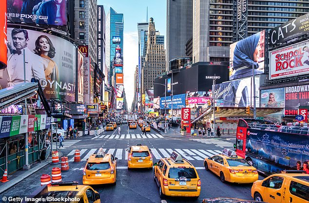 Vibrant: New York's famous Times Square, which is currently off-limits to UK tourists