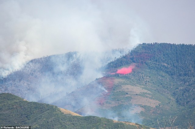 An aerial shot of the fire that is burning across Utah. The fire is moving rapidly and causing visibility to be low due to smoke