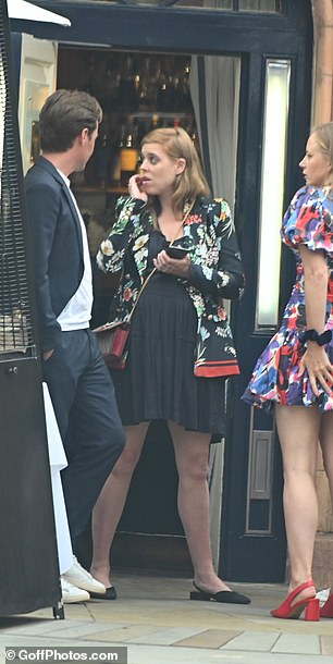 Beatrice appeared to be deep in thought as she chatted with her husband and friends after the lunch