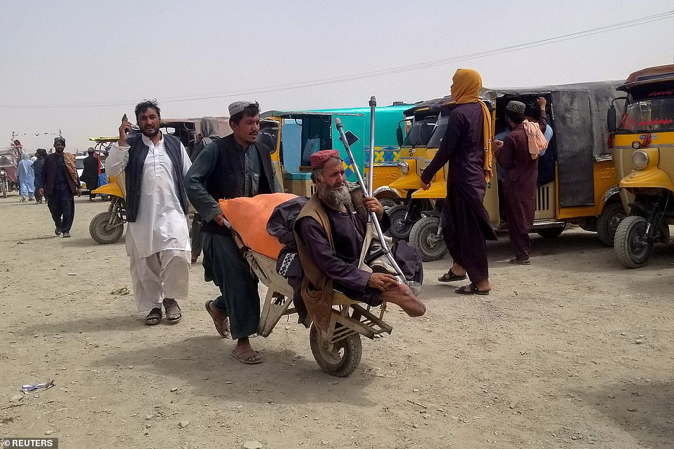 Pictured: People arriving from Afghanistan make their way at the Friendship Gate crossing point at the Pakistan-Afghanistan border town of Chaman, Pakistan August 16, 2021