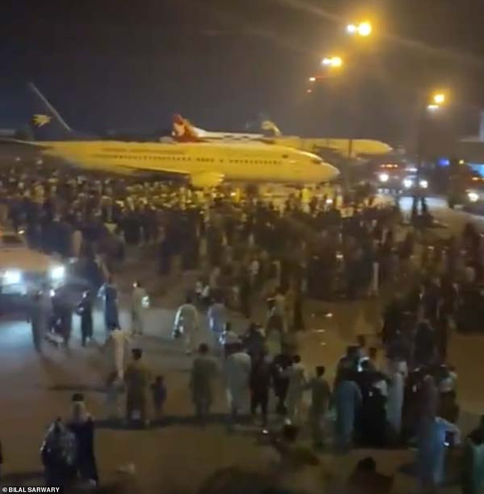 A NATO official said all commercial flights had been suspended and only military aircraft were allowed to operate. The alliance said it was helping to keep the airport running (pictured: Scenes at Kabul airport)