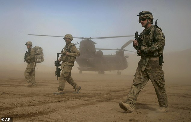 President Joe Biden ordered about 6,000 troops (US soldiers pictured in Kabul in 2012) to help evacuate US staff 'and other allied personnel' from Afghanistan as the Taliban continues to overtake the country