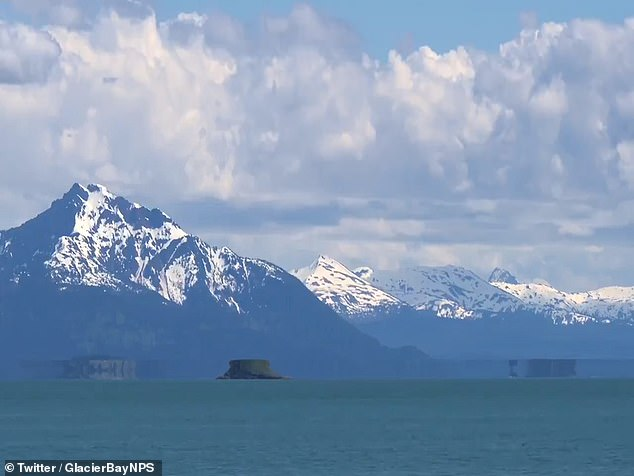 Amazing video footage has emerged that shows what looks like a flying saucer hovering above the water in a bay in Alaska