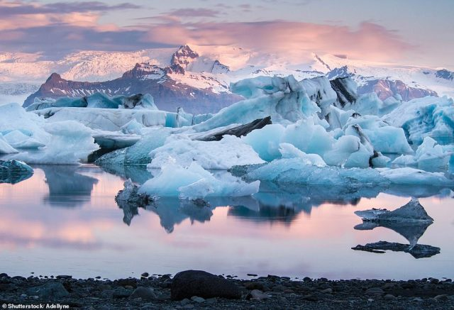 JOKULSARLON, ICELAND: This large glacial lake, in Vatnajokull National Park, was formed by the melt from the Breioamerkurjokull in 1934¿35. 'The lake has quadrupled in size since the 1970s as the glacier has retreated from the coast,' Martin says. 'It is now the deepest lake in Iceland, reaching 284m (932ft). Glaciologists think it probable that a deep fjord will eventually be worn on the site of the lake'