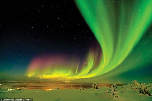 NORTHERN LIGHTS, LAPLAND, FINLAND: According to Martin, in northern Lapland, the Northern Lights can be seen on clear nights between September and March. 'The lights are caused by the solar wind, which passes on energy to gases in Earth¿s atmosphere, which release that energy as light,' she writes. 'Earth¿s magnetic field guides the solar wind towards the poles'