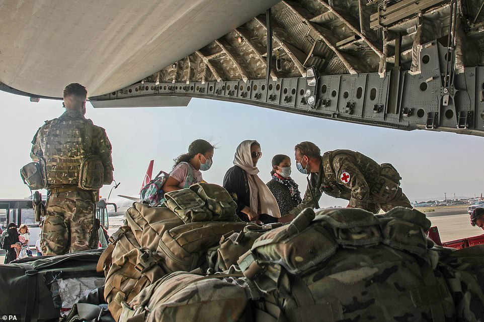 BRITAIN: British soldiers evacuating foreign nationals and dual nationals on military jets in Kabul on Tuesday. There was no sign of any American plane