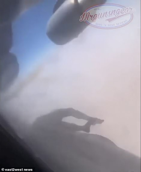 The body of an Afghan man is trapped in the wheel arch of a C-17 transport plane