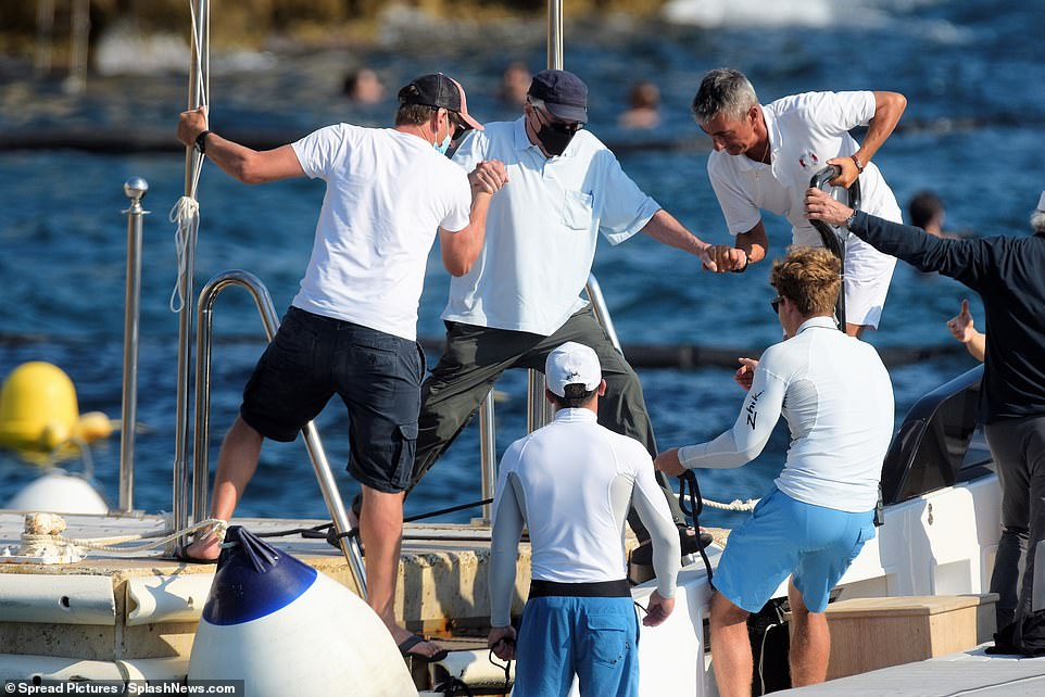 Support needed: De Niro seemed in good spirits on the trip, despite needing some support to jump on board the vessel