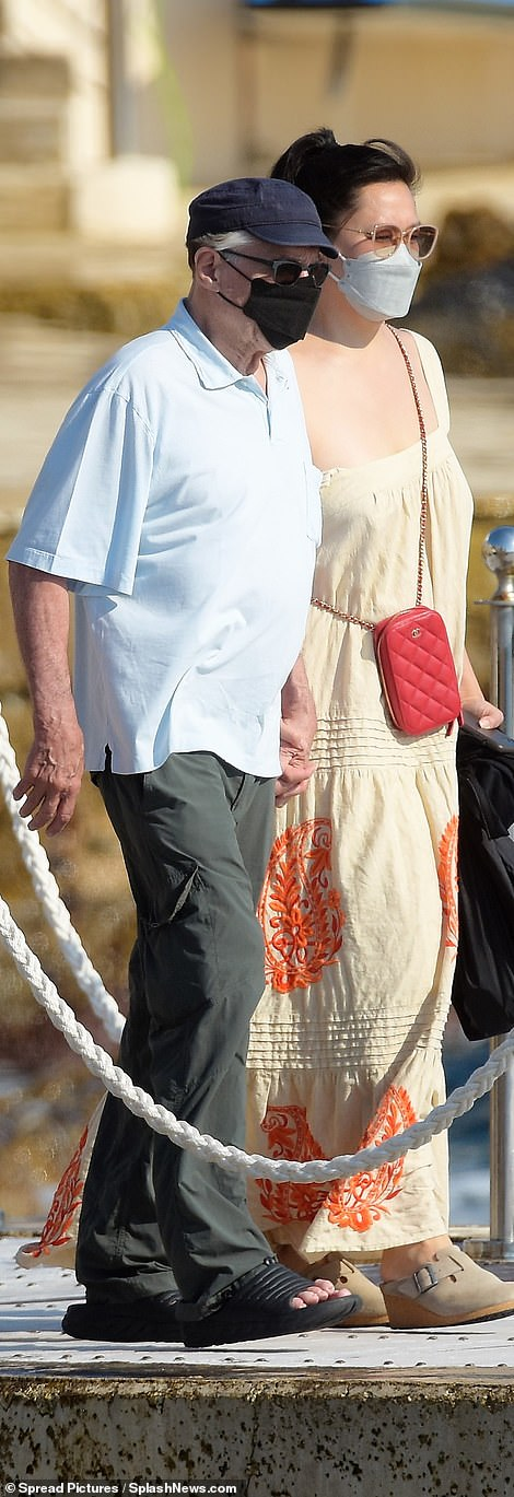 Enigma:The Hollywood superstar was spotted cosying up to the enigmatic brunette as they left the luxe Hotel du Cap-Eden-Roc by boat