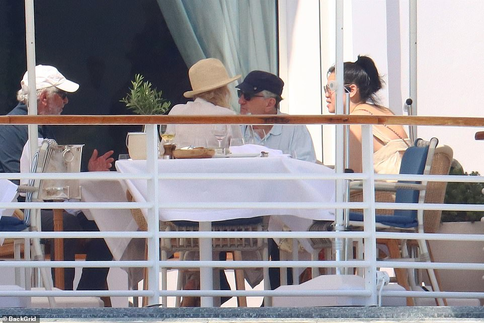 Time to chill: The group were later seen sitting down for lunch following their stroll
