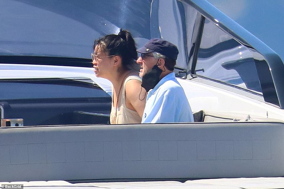 Chill time: The pair looked relaxed as they sat close to each other in a boat