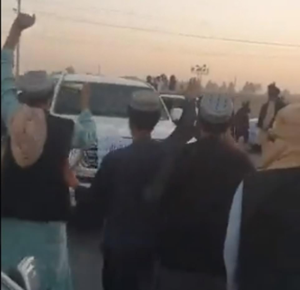 The Taliban have posted a triumphalist video seemingly showing one of its cofounders arriving to a hero's welcome in Kandahar and locals cheering on a motorcade