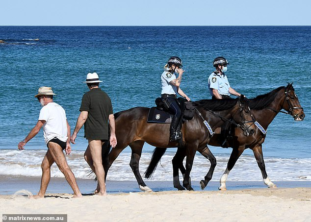 Ingraham delivered her attack on the same day Sydney recorded 345 new cases, up from 344 a day earlier (pictured, police patrolling Bondi on Monday)