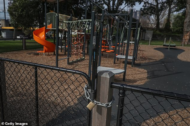 A gate to a playground is seen padlocked in Melbourne's South Yarra on Tuesday (pictured) after outdoor recreation was banned to curb the spread of the Delta variant