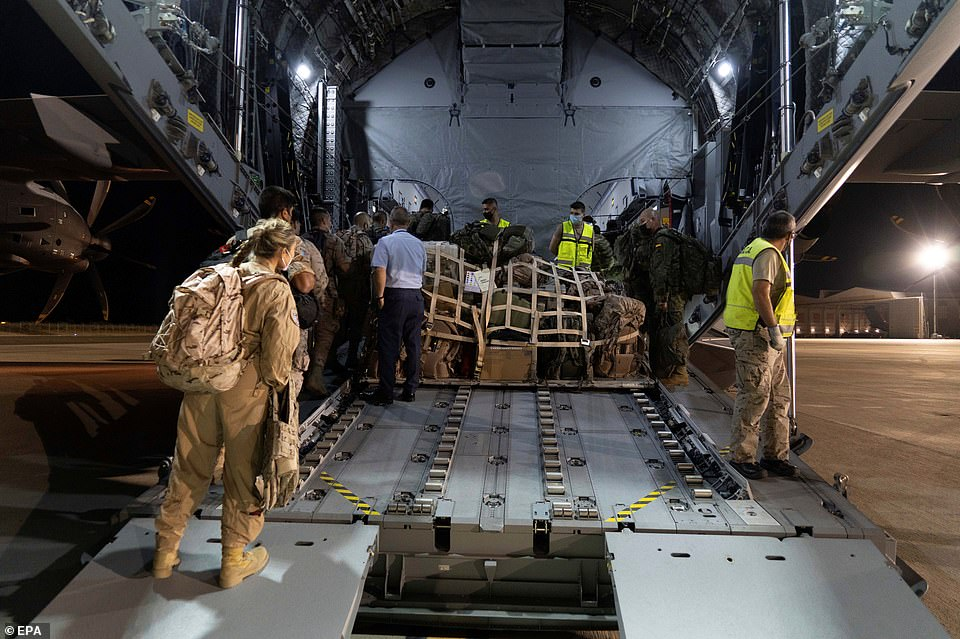 Spanish troops are loaded on board an Airbus transport plane in Zaragoza, bound for Kabul airport where evacuation missions have resumed