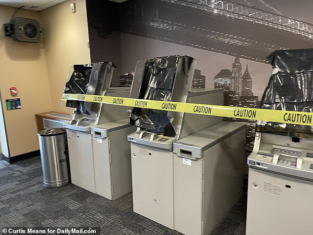 The smashed ATMs (pictured) seen in the aftermath of the brutal attack