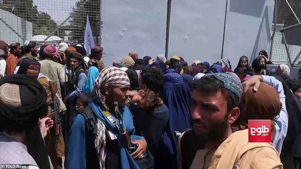 Taliban gunmen patrol through crowds of desperate Afghans at Kabul airport today, as people try to board planes out of the country fearing for their safety under Islamist rule