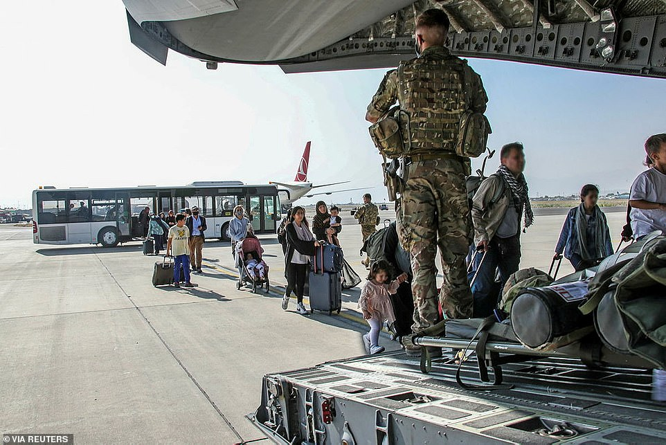 I am approved at last ¿ but will the call ever come for the flight? Will the airport still be open? writes Latif Hottak (pictured: Britishcitizens and dual nationals residing in Afghanistan board a military plane for evacuation from Kabul airport)