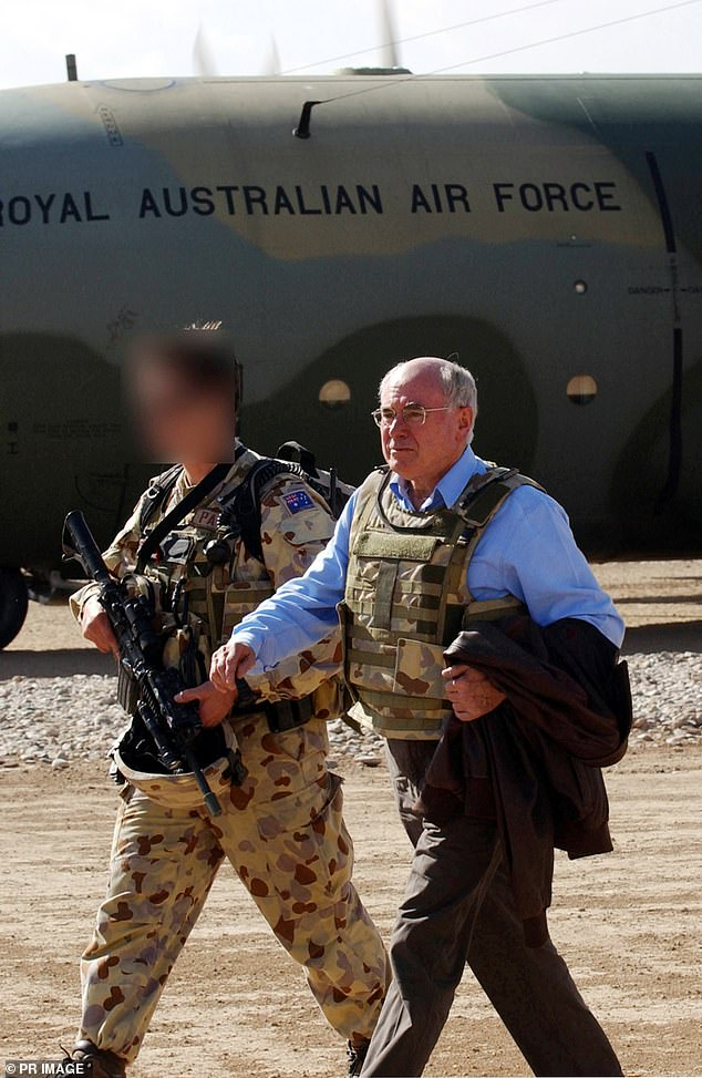John Howard is seen arriving in Afghanistan during his time as Prime Minister back in November 2005 (pictured) during a top secret visit to the Australian Special Operations Task Group