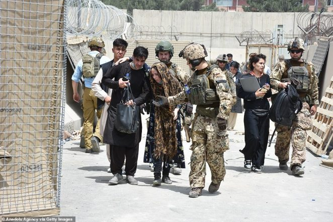 Inside the airport, soldiers are helping those who have been able to get through and are putting them on flights but outside, it is total chaos run by the Taliban