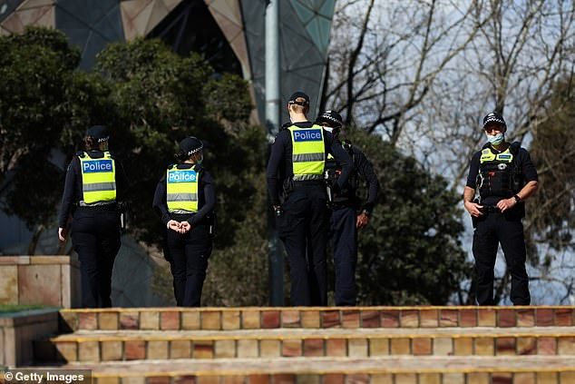 Despite the desperate times, many have slammed the state's curfew laws, calling the measure an over-reach that's not based on science (pictured, police patrol Melbourne)