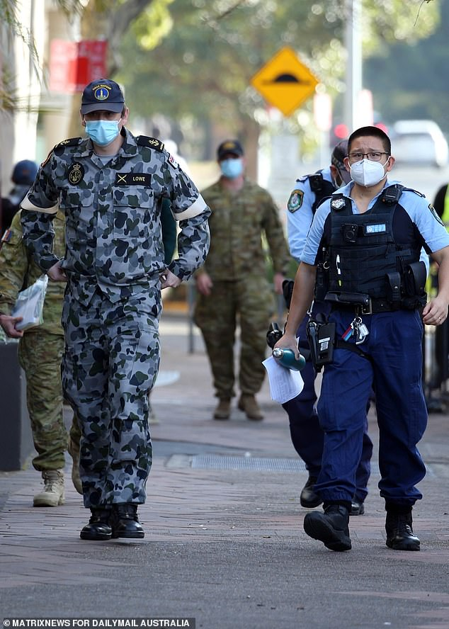 Police and ADF personnel are pictured patrolling the Bankstown LGA in Sydney's south-west on Thursday