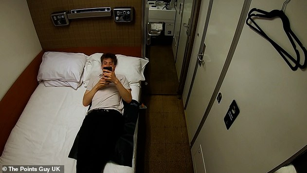 Liam Spencer in his £395 double-bed cabin, which featured a shower and toilet