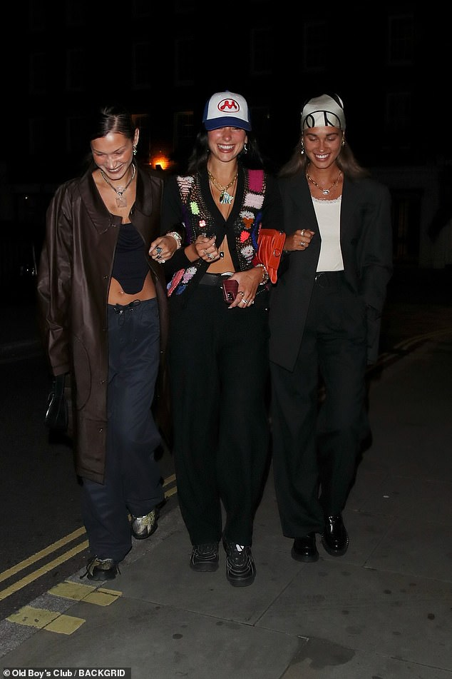 All smiles: The girl gang looked in high spirits as they stepped out for dinner together