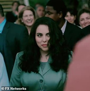Same smile: Monica is again seen in the trailer, this time at an outdoor event smiling at Clinton