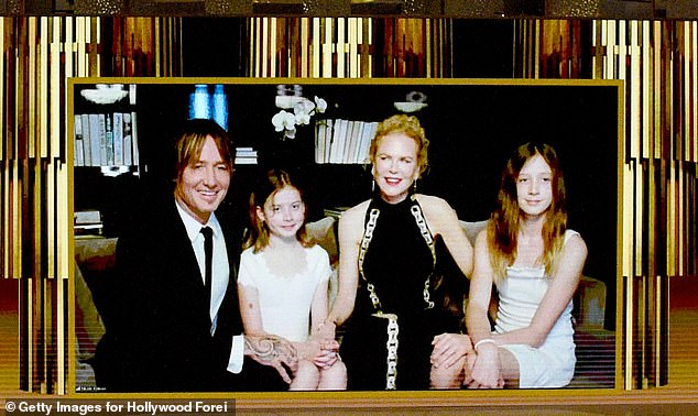 Family: Nicole and her country music superstar husband are doting parents to daughters Sunday Rose, 13 (right), and Faith Margaret, 10 (left). The couple celebrated 15 years of marriage in June. Pictured is the family together at the 2020 Golden Globes