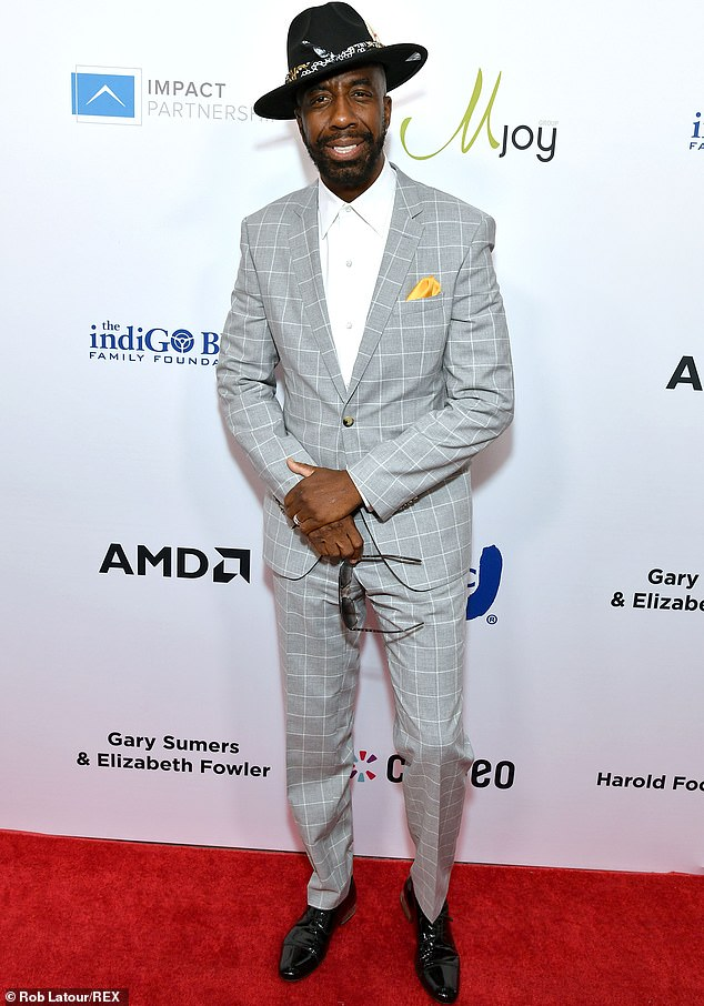 Dapper:JB Smoove sauntered across the red carpet in a checked silver suit and white shirt, accenting the look with a black hat and gold pocket square