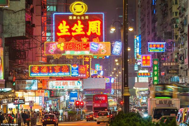 Buzzing: Kowloon is a 'raucous, mercantile farrago of fast food, fast fashion, fast living and slow traffic', writes Rob Crossan