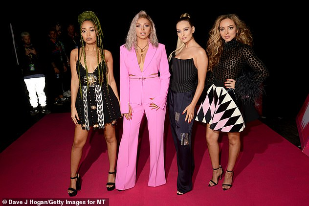 Going solo: The star said an emotional goodbye to her Little Mix bandmates last year (pictured with Leigh-Anne Pinnock, Perrie Edwards and Jade Thirlwall in 2018)