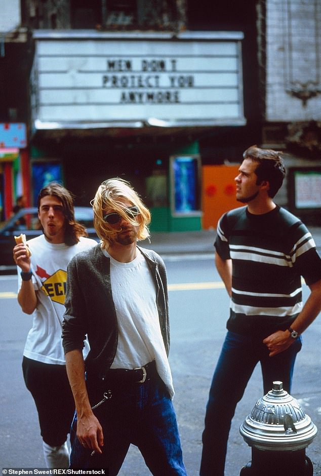 Reflecting: The musician also briefly spoke about his older band and noted that they 'became huge overnight'; he is seen with Kurt Cobain and Krist Novoselic in 1993