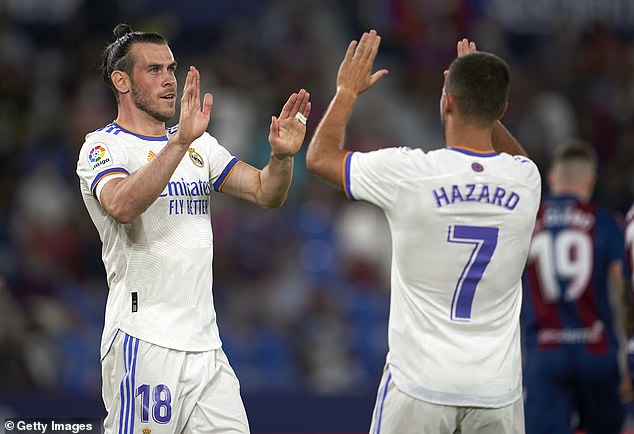 Gareth Bale celebrates with Eden Hazard after opening the scoring for Real Madrid