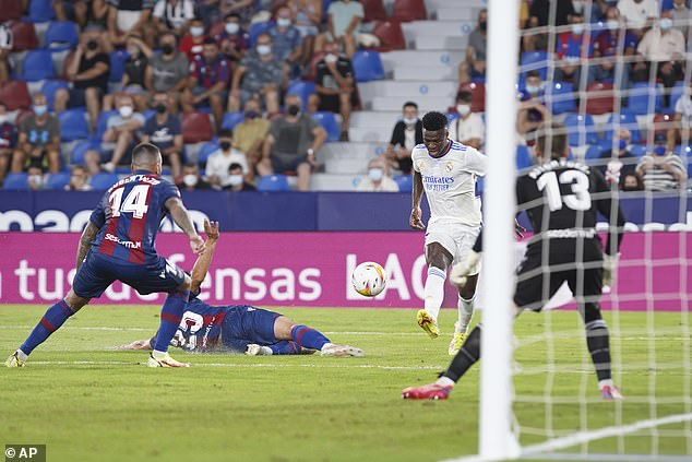 Vinicius Junior steered his finish across goal to equalise a second time in the 85th minute