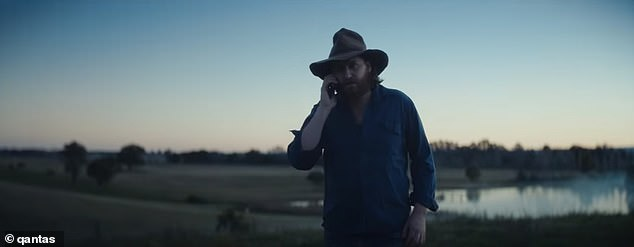 New ad: Featuring the uplifting track Fly Away by Melbourne singer Tones and I, the 90-second tearjerker takes viewers on a rollercoaster of emotions. Pictured: a rural Australian in the ad separated from his daughter overseas