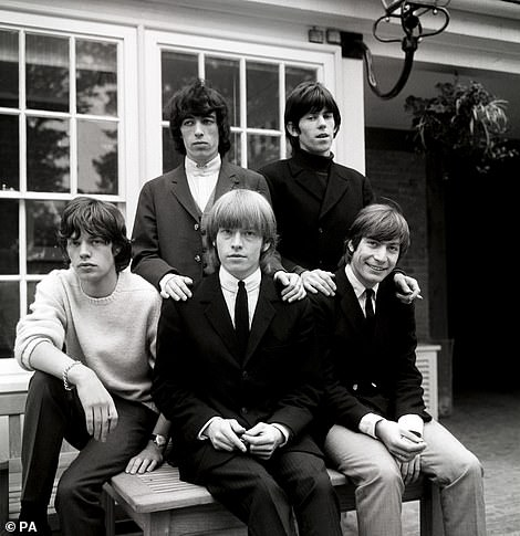 Often at odds with his flamboyant band, The Rolling Stones drummer Charlie Watts (pictured right with the band in 1964) was the quiet, considered and skilful force that kept his group in time.