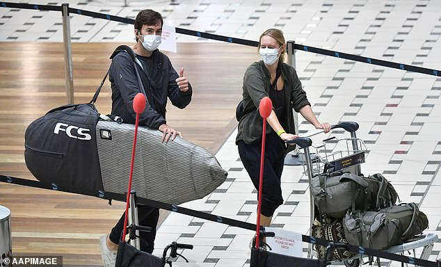 From 12pm Wednesday people entering Queensland will not be permitted to enter on a right of entry pass and would need to reapply for a border pass to be allocated a time to enter in another fortnight (pictured - travellers wearing masks in Queensland)